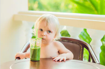 Kid Drinking Green Juice